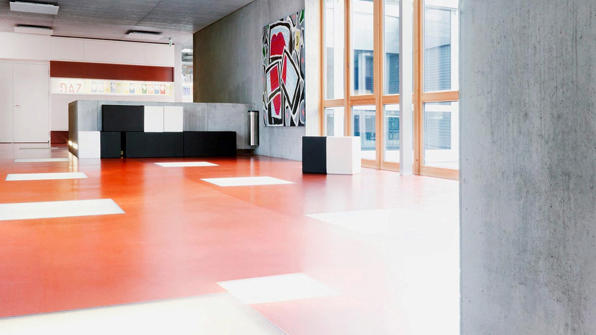 Education sector: Red Forbo linoleum floor in a school.