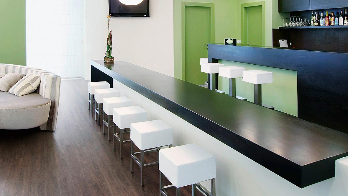 Gastronomy, hotel and leisure: bar area in a hotel with dark Forbo LVT (Allura Luxury Vinyl Tiles).