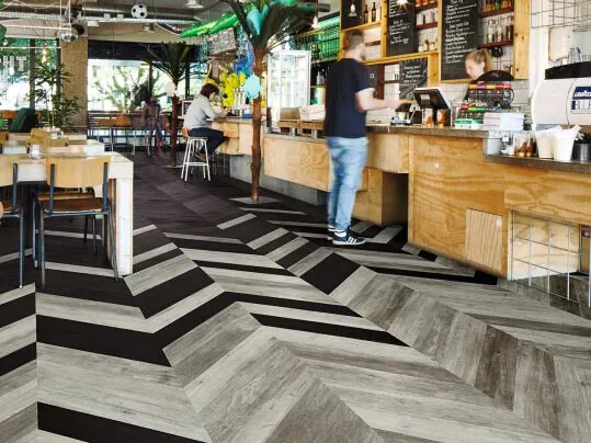 Luxury vinyl wood planks - hungarian point design for hospitality flooring