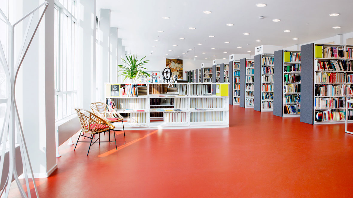 Education sector: library with red Forbo linoleum floor.