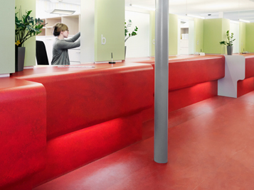 Offices and public buildings: counter area, finished in red Forbo linoleum.