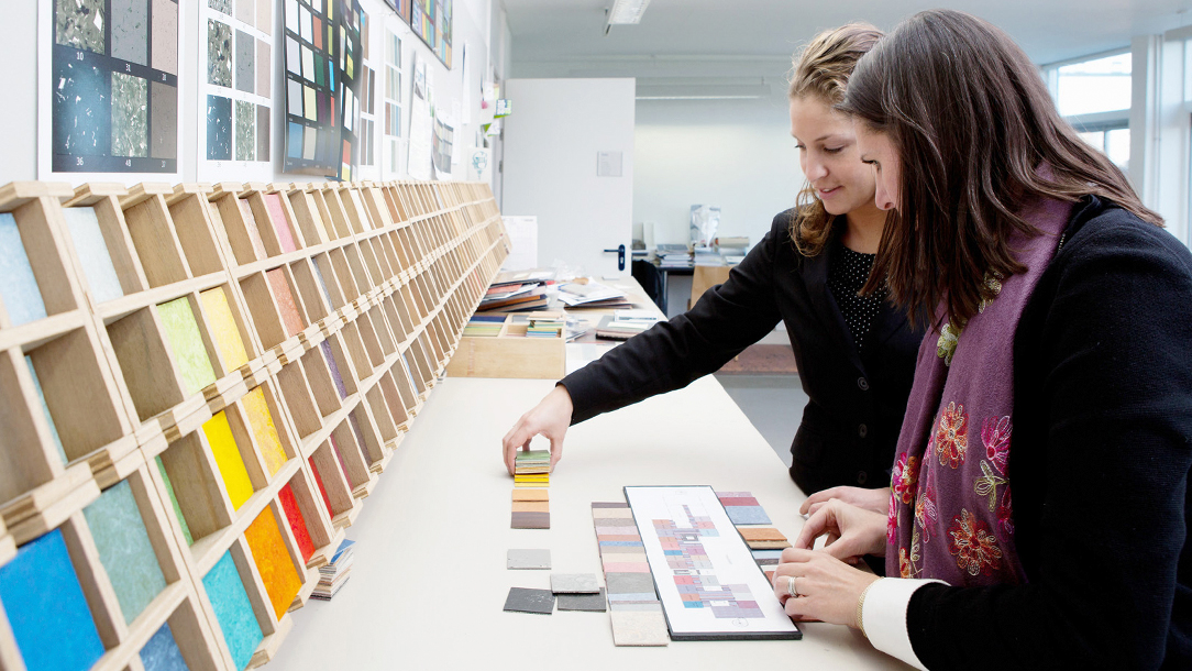 The Forbo design team at work with various color samples.