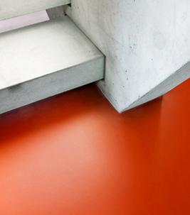 Bildungswesen: Roter Forbo Linoleum Boden bei Treppe.