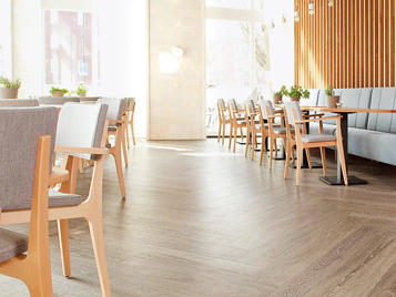 Nursing care and social housing: chairs and tables in a nursing home with LVT floor (Forbo Allura Luxury Vinyl Tiles).