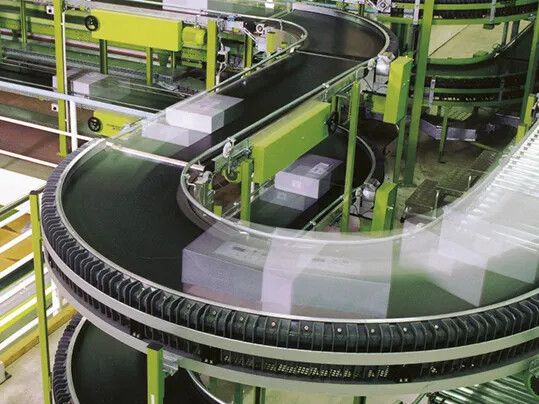 Curved conveyor in a distribution center.
