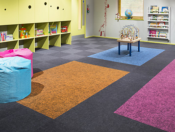 Flotex, the washable textile floor covering, in tile format in a kindergarten. A product line that has been part of the Forbo  product portfolio since the acquisition of Bonar Floors in 2008.