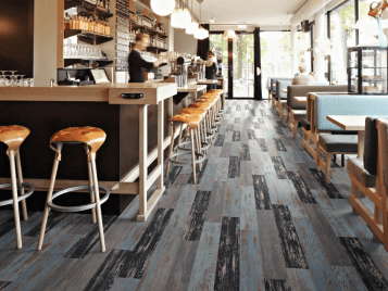 Allura Wood luxury vinyl tile (LVT) i café