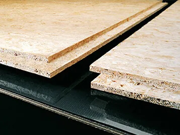 Transilon processing belt in particle board production