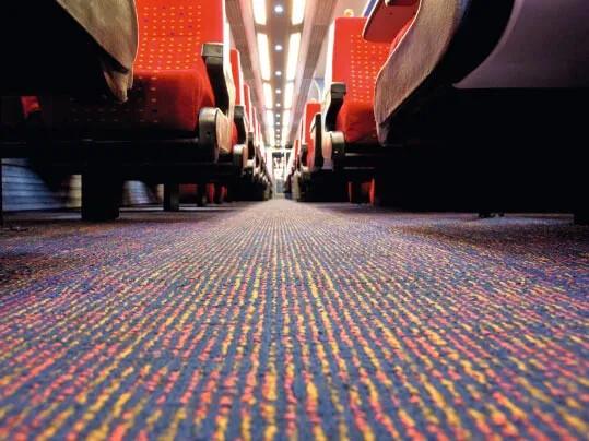 Tessera textilmatta i tågvagn
