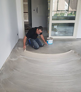 spreading flooring adhesive